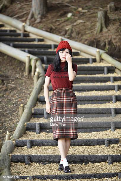 a young woman standing on the steps on narrow path - mishima city stock photos and pictures