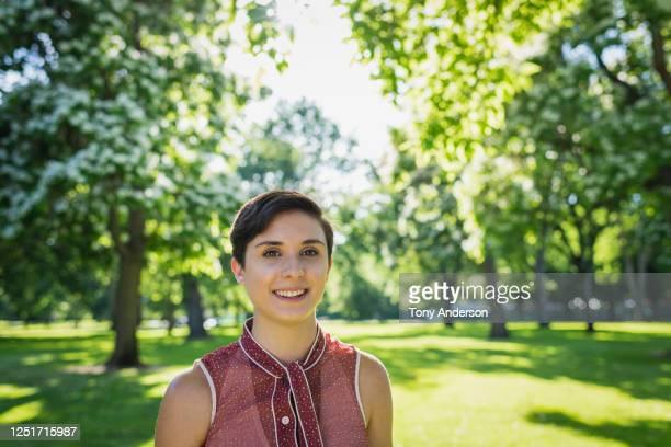 young woman standing outdoors - bisexuality fotografías e imágenes de stock
