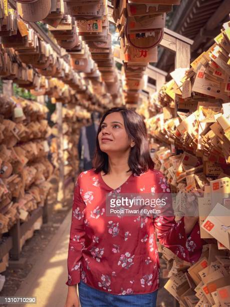 young woman standing outdoors - kawagoe stock pictures, royalty-free photos & images