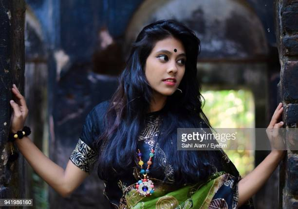 young woman standing outdoors - bindi stock pictures, royalty-free photos & images