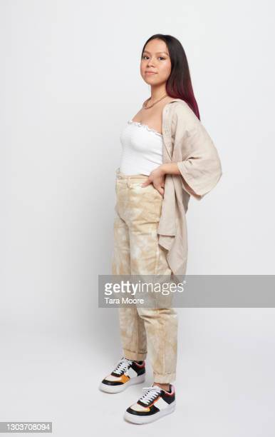 young woman standing - full length stock pictures, royalty-free photos & images