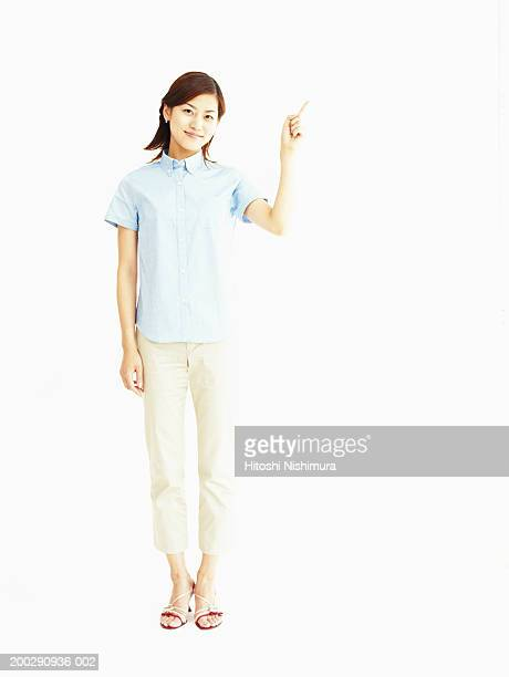 young woman standing, portrait - 半そで ストックフォトと画像