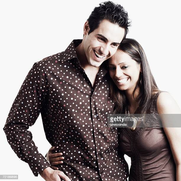 young woman standing with her arm around a young man - polka dot stock pictures, royalty-free photos & images