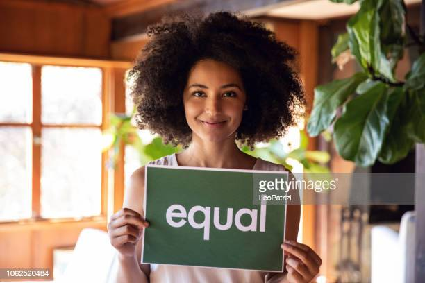 young woman stands for equal rights. - social issues stock pictures, royalty-free photos & images
