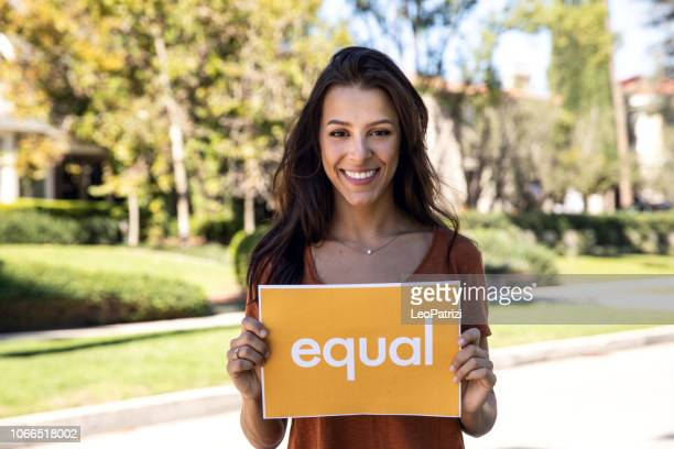 Young woman stands for equal rights