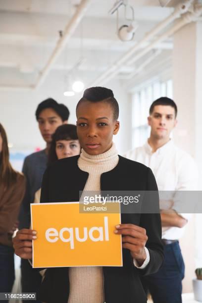 young woman stands for equal rights - preconceito racial imagens e fotografias de stock