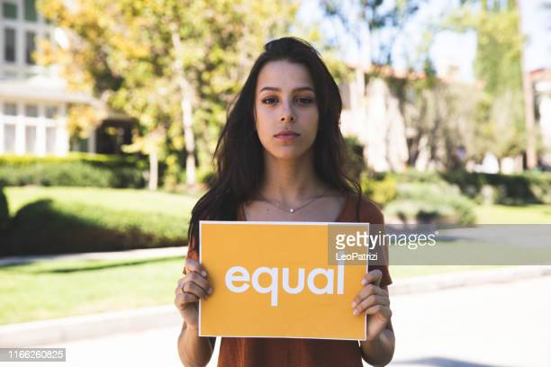 young woman stands for equal rights - social movement stock pictures, royalty-free photos & images