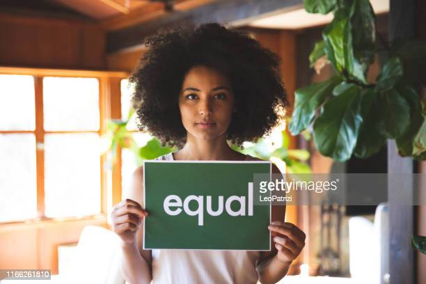 young woman stands for equal rights - social justice concept stock pictures, royalty-free photos & images
