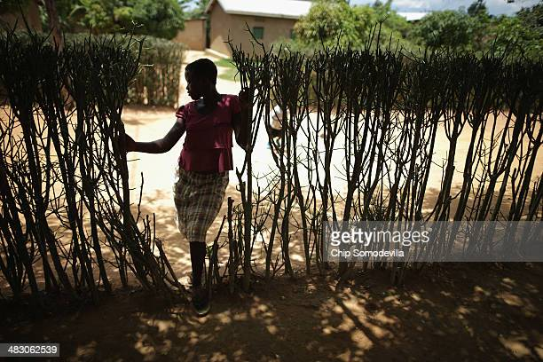 A young woman stands in an opening of a hedgerow of a genocide reconciliation village April 6 2014 in Mybo Rwanda Organized by the Prison Fellowship...