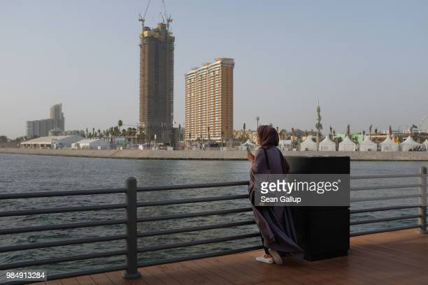 A young woman stands on a fishing pier on the Corniche waterfront on June 23 2018 in Jeddah Saudi Arabia The Saudi government under Crown Prince...