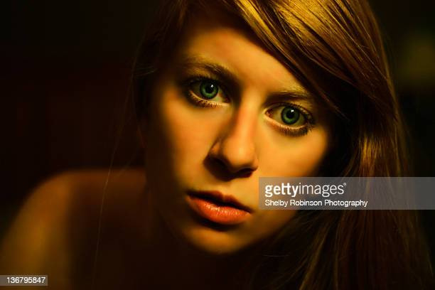 young woman stare into camera - girls flashing camera stock pictures, royalty-free photos & images