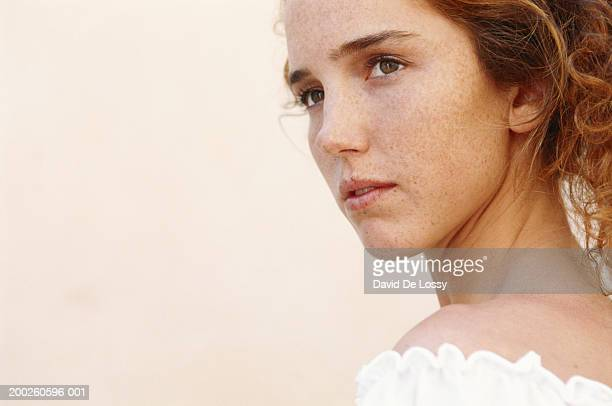 young woman staring, close-up - one young woman only stock pictures, royalty-free photos & images