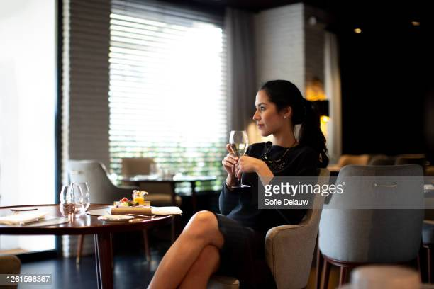 young woman staying in boutique hotel enjoying aperitif - italian culture stock pictures, royalty-free photos & images