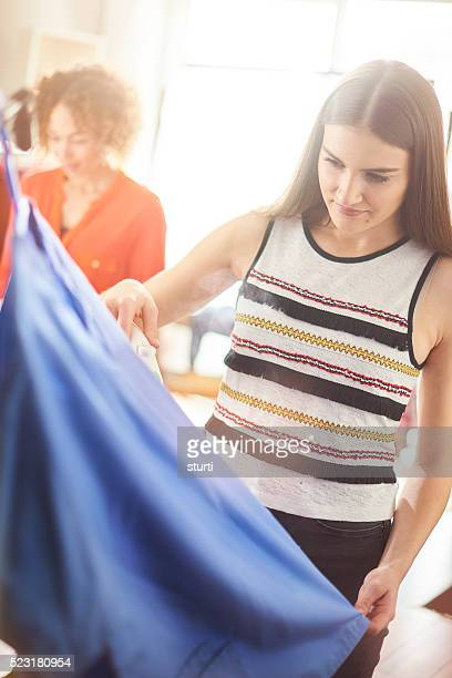 young woman steaming her garment