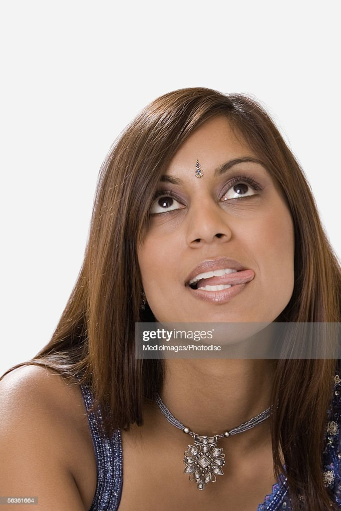 Young woman sticking out her tongue : Stock Photo