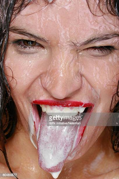 young woman sticking tongue, portrait - thick white women stock photos and pictures