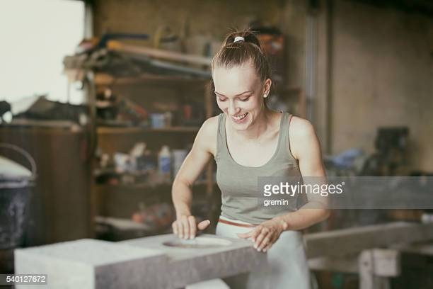 Young woman stonemason in her workshop