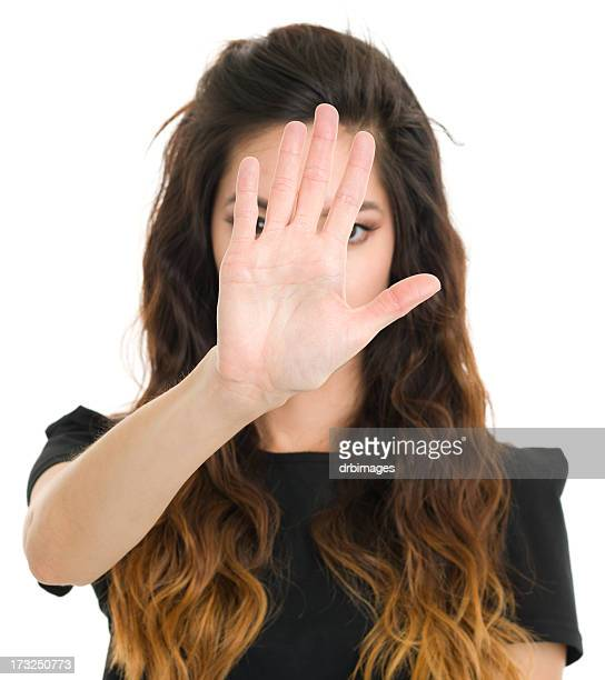 young woman stop hand gesture - obscured face stock pictures, royalty-free photos & images