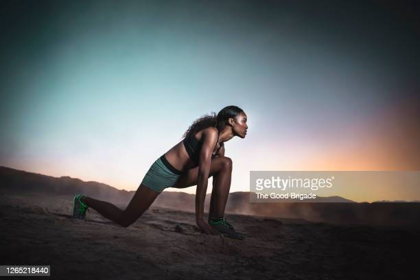 young woman stretching in mojave desert at dusk - preparation stock pictures, royalty-free photos & images