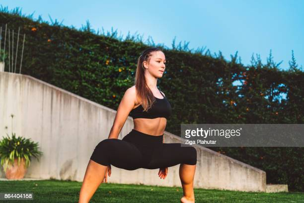 Young woman stretching in the back yard