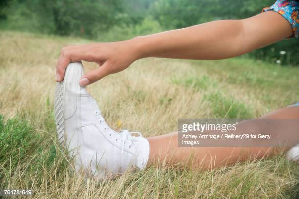 Young Woman Stretching Outside