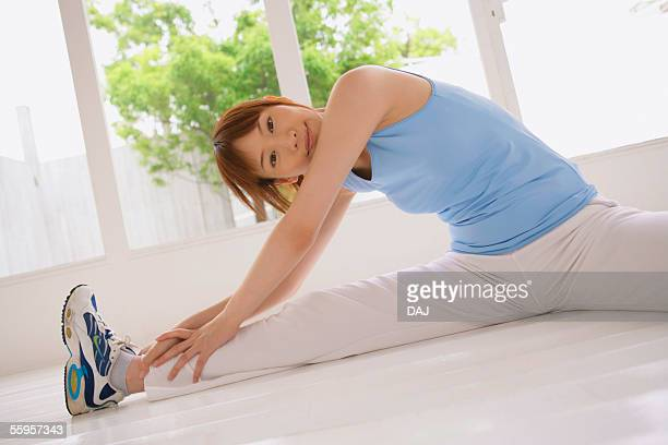 young woman stretching - woman open legs stock photos and pictures
