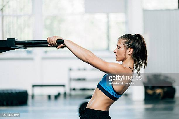 young woman stretching - daily sport girls stock pictures, royalty-free photos & images