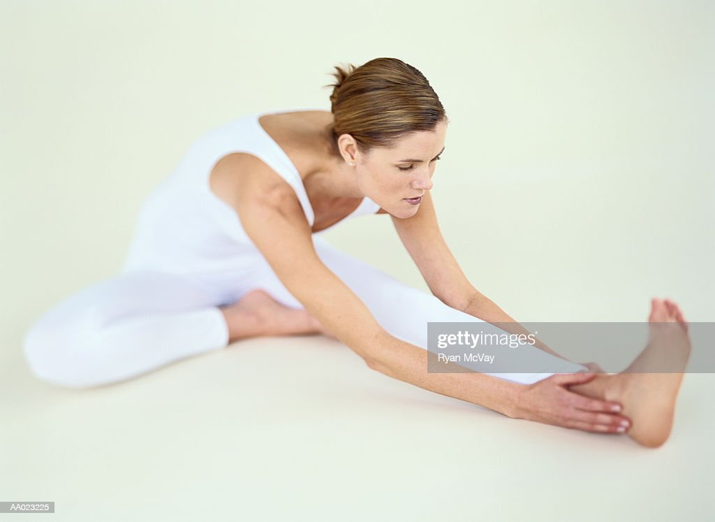 Young woman stretching : Stock Photo