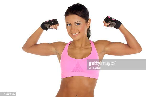 Young Woman Striking a Fitness Pose - Isolated