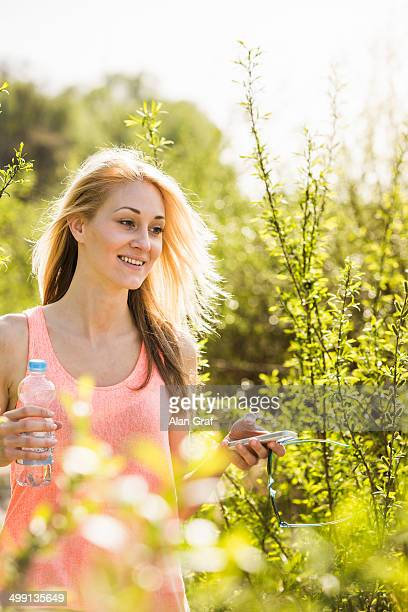 Young woman strolling in sunlit forest