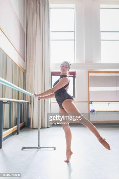 young woman student rehearsing in dance studio - ballettstudio stock-fotos und bilder