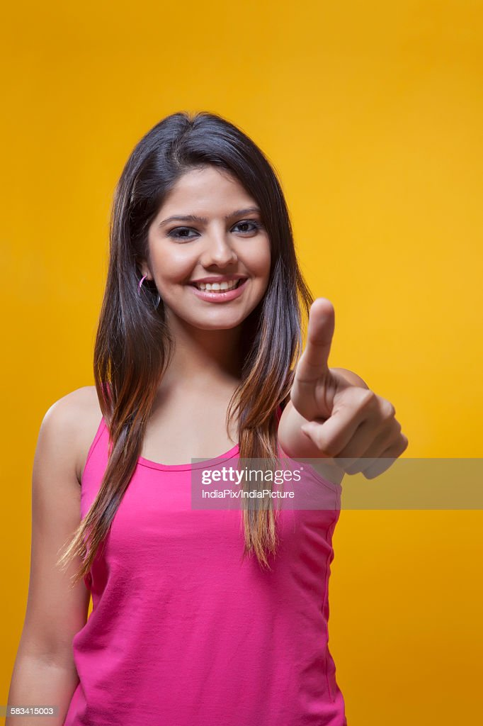 Young woman student with thumbs up : Stock Photo
