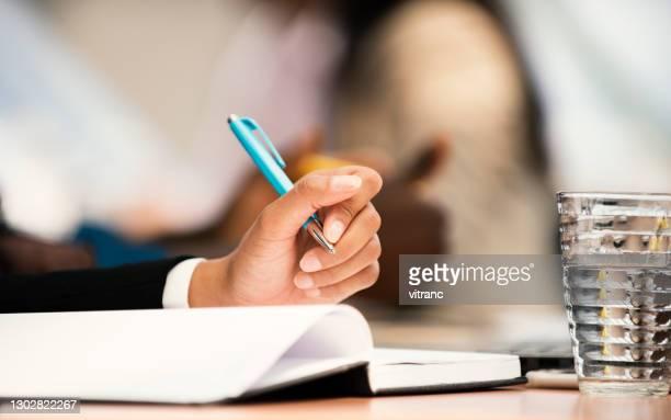 young woman student writes information from portable net-book - portable information device imagens e fotografias de stock
