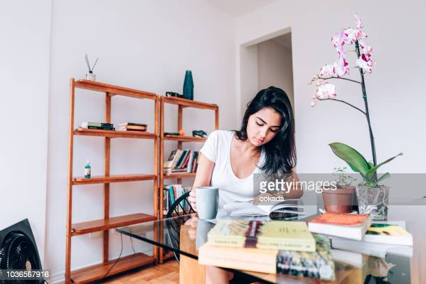 young brazilian woman studying at home