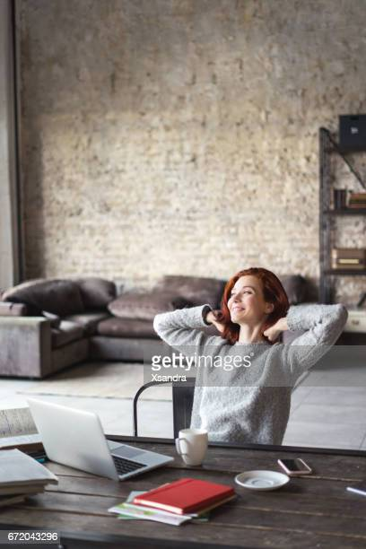 Young woman studying in a loft apartment