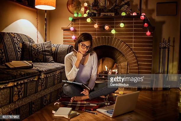 young woman studying in her cozy room