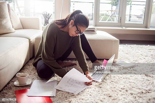 young woman studying in her living room