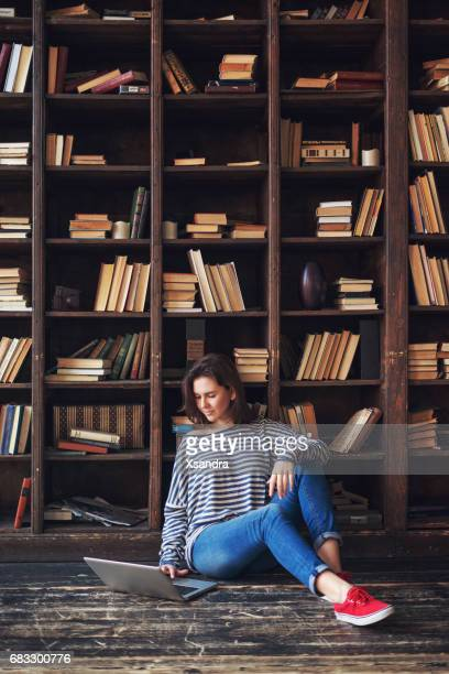 Young woman studying in the library