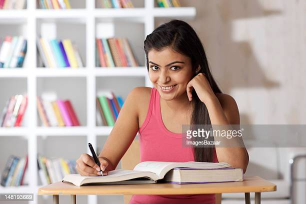 Young woman studying, portrait