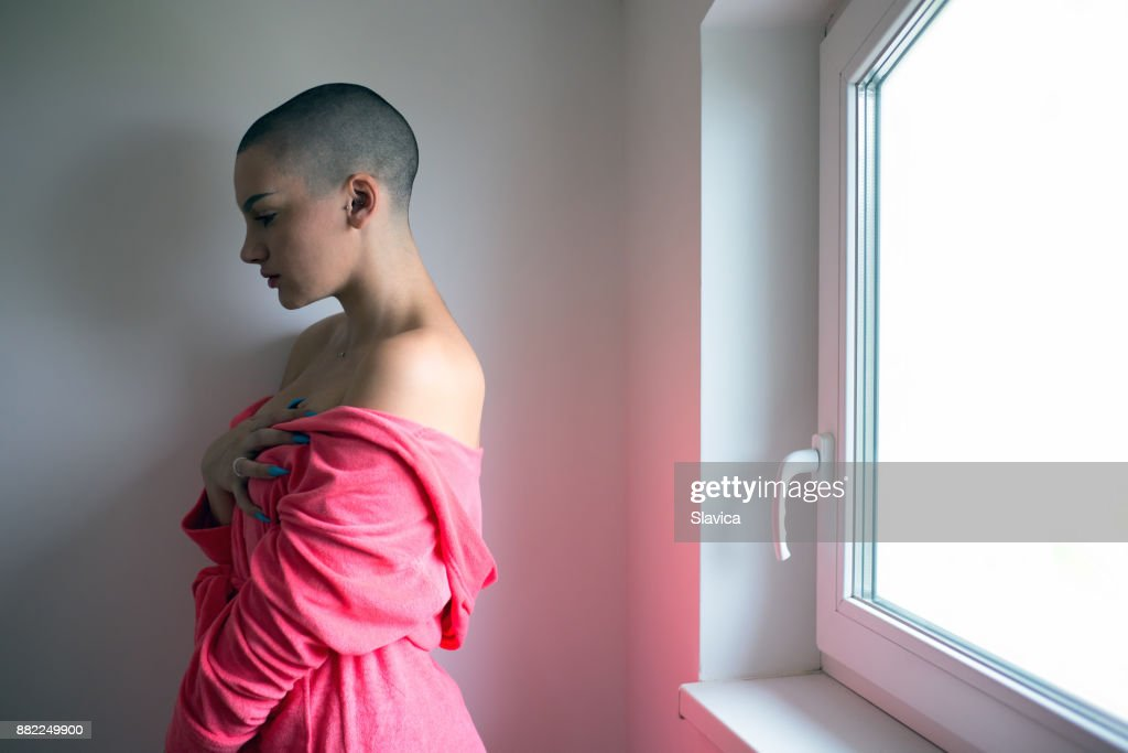 Young woman suffering from cancer : Stock Photo