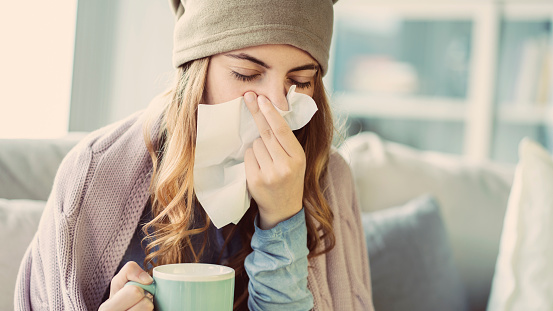 Young woman suffering from cold 1161792469