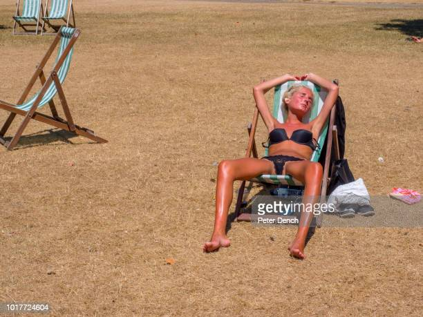 A young woman sunbathes in Hyde Park sat on a deck chair wearing her bra and panties After some of the worst weather the United Kingdom had seen for...
