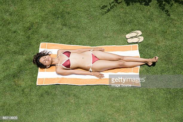 young woman sunbathing - women sunbathing stock photos and pictures