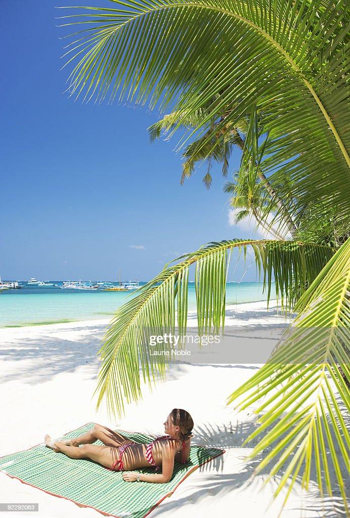 Young Beautiful Woman In Beach Hat Walking Under Tropical