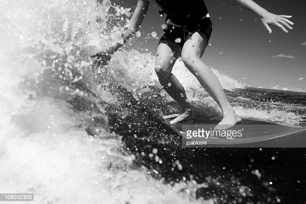 young woman surfing, black and white