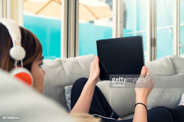Young woman surfing the net on her tablet