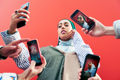 Young woman surrounded by smartphones. - gettyimageskorea