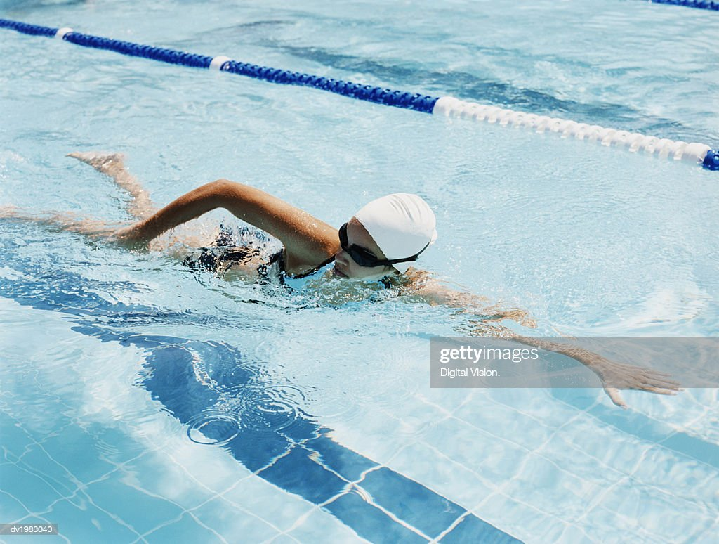Young Woman Swimming in a Pool : Stock Photo