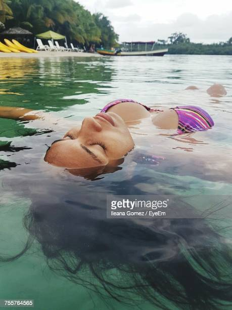 Young Woman Swimming In Sea
