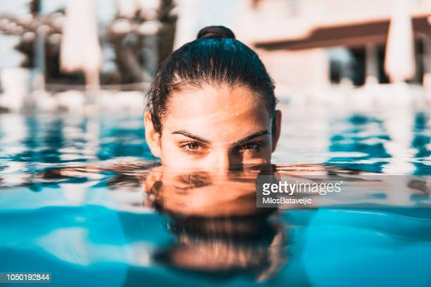 young woman swimming in the pool - piscina foto e immagini stock